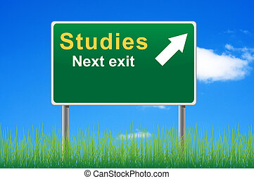 Studies road sign on sky background, grass underneath.