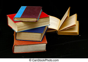 studies - stack of four old books, another with pages open