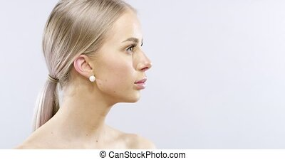 Studio beauty portrait of woman with long blonde hair