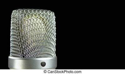 Studio Condenser Microphone Rotates on a Black Background