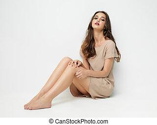 studio fashion portrait of young woman posing