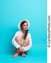 studio, fashion portrait, young woman, blue background