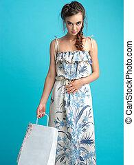 studio, fashion portrait, young woman shopping