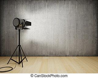 Studio light illuminates the wall