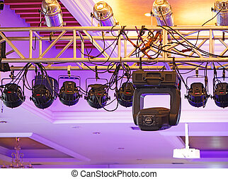 Studio lighting equipment high above an outdoor theatrical ...