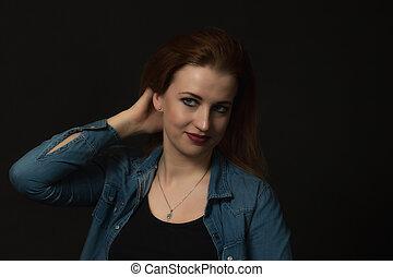 Studio low key portrait of beautiful woman