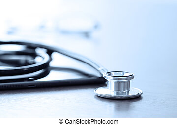 Studio macro of a stethoscope and digital tablet with...