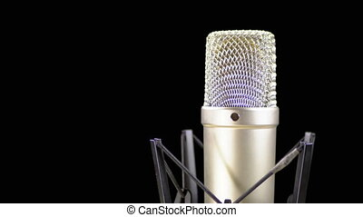 Studio Microphone with Spider Rotates on a Black Background
