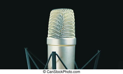 Studio Microphone with Spider Rotates on a Black Background....
