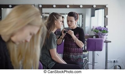 Studio of beauty. The master in a make-up trains the student...