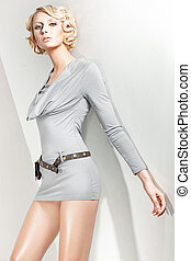 Studio photo of an attractive blond beauty