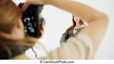 Studio Photo Session - Beautiful young female model dressed...