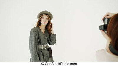 Studio Photo Session - Pretty slim young woman dressed in...
