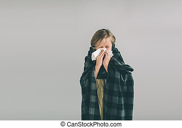 studio picture from a young girl with handkerchief. Sick child isolated has runny nose. girlie makes a cure for the common cold. Nerd is wearing glasses.