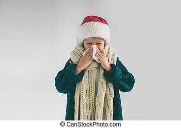 studio picture from a young girl with handkerchief. Sick child isolated has runny nose. Little Female model makes a cure for the common cold