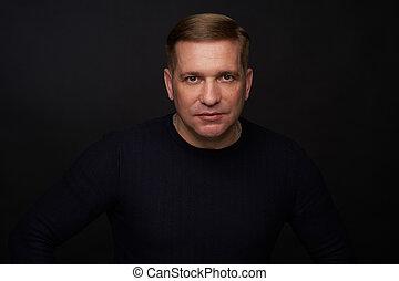 Studio portrait of a 40 years old caucasian man