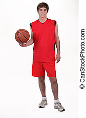 Studio portrait of a basketball player wearing a red kit