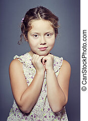 Studio portrait of a beautiful girl with curly hair