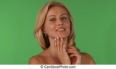 Studio portrait of a beautiful mature woman touching her...