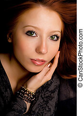 Studio portrait of a beautiful young girl with red hair