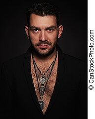 fashionable handsome bearded man. Black background