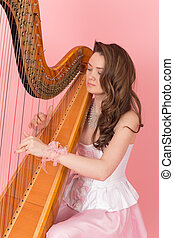 girl playing music on a harp