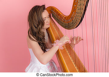 girl playing the harp