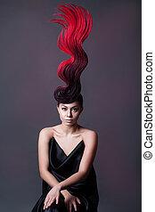 studio portrait of a girl with a fiery hairdo
