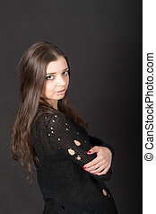 girl with long hair on a black background