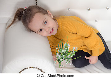 girl on a white sofa