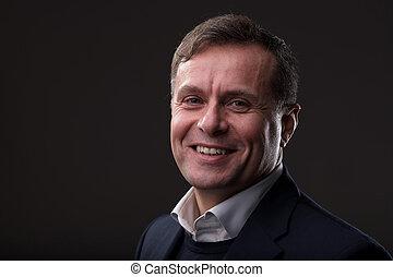 portrait of a mature smiling business man
