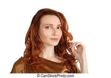 Studio portrait of a middle age red-haired woman over white