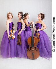 studio portrait of a musical quartet