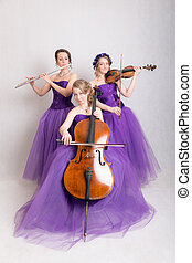 musical trio in evening gowns