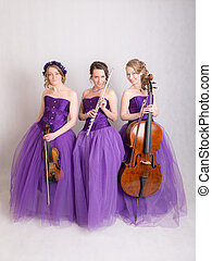 studio portrait of a musical trio