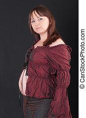 studio portrait of a pregnant woman