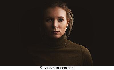 studio portrait of a pretty woman
