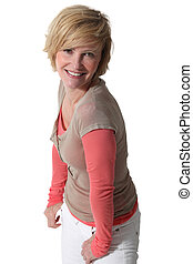 Studio portrait of a smiling blonde woman in her thirties