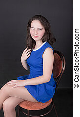 teenager girl on a chair