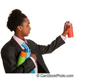 African American man spraying graffiti