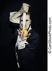 young man with a knife and an orange