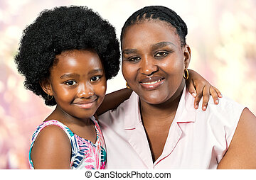 Studio portrait of african mother and little daughter.