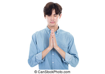 Studio portrait of an asian young male praying