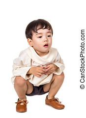 Studio portrait of asian male child squatting