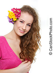 studio portrait of attractive young girl with flowers