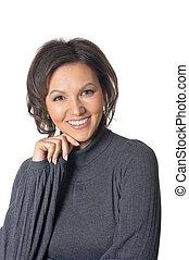 Studio portrait of beautiful brunette woman on white background