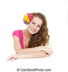 studio portrait of beautiful young girl with flowers