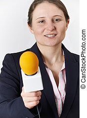 Studio Portrait Of Female Journalist With Microphone