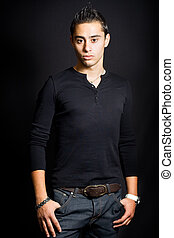 Studio portrait of masculine young man - Studio portrait of...