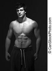 Studio Portrait Of Muscular Teenage Boy
